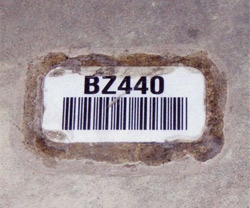 Heavy duty floor label for bulk storage warehouse